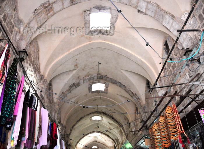 israel476: Jerusalem, Israel: Souq Al Qattanin / Suq El Qatanin, i.e. Market of the Cotton Merchants, aka Suq of Amir Tankaz al-Nasiri - vaulted roof and hanging textiles, arched ceiling with a barrel-shaped vault divided into sections with skylights, for ventilation and illumination - Crusader market improved by the Mamluks - the suq contains a caravanserai, two hammams, and two rows of 30 shops - west side of the Haram al-Sharif, Muslim Quarter - photo by M.Torres - (c) Travel-Images.com - Stock Photography agency - Image Bank