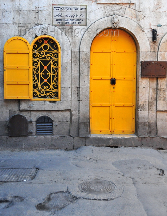 israel488: Jerusalem, Israel: ancient façade of a former burghul factory, with yellow door and window on Armenian Orthodox Patriarchate Road - Bulghourji Armenian Restaurant and Lounge - wrought Iron Latticework - Armenian quarter - photo by M.Torres - (c) Travel-Images.com - Stock Photography agency - Image Bank