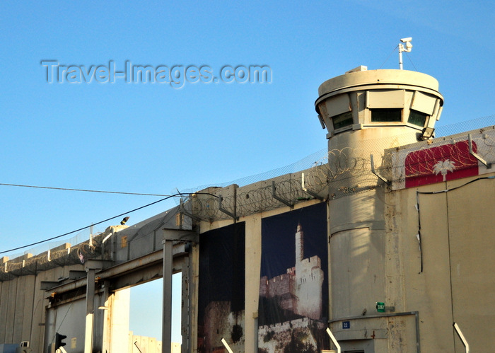 israel493: Jerusalem, Israel: Rachel's Tomb Crossing Checkpoint, main vehicle gate leading to  Bethlehem and watch tower - part of the Israeli West Bank barrier, security fence made of concrete slabs - poster with David's tower -  Israeli Defense Forces (IDF) - photo by M.Torres - (c) Travel-Images.com - Stock Photography agency - Image Bank