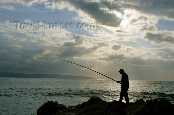 israel61: Israel - Akko / Acre: a fisherman tries his luck in the Mediterranean - photo by J.Kaman - (c) Travel-Images.com - Stock Photography agency - Image Bank