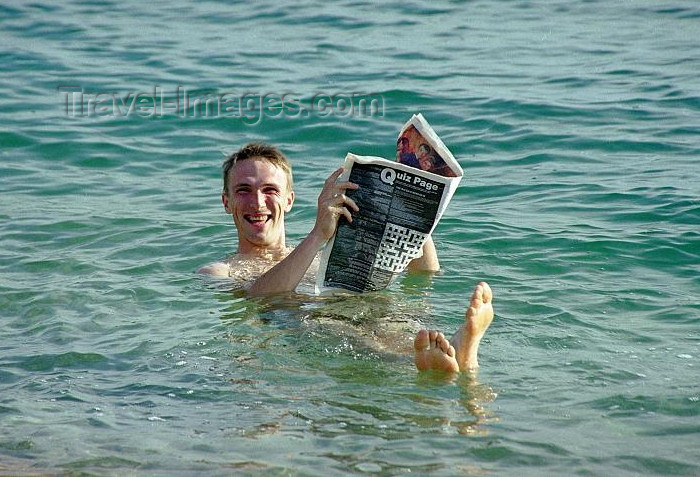 israel75: Israel - Dead sea: reading a newspaper while floating - buoyancy caused by high salinity - photo by J.Kaman - (c) Travel-Images.com - Stock Photography agency - Image Bank