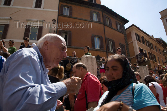 italy364: Rome, Italy: old man telling off gypsy woman in Fontana di Trevi - photo by I.Middleton - (c) Travel-Images.com - Stock Photography agency - Image Bank