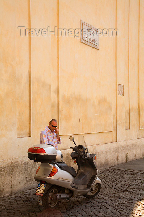 italy370: Rome, Italy: Local man on mobile phone in Piazza San Silvestro - photo by I.Middleton - (c) Travel-Images.com - Stock Photography agency - Image Bank