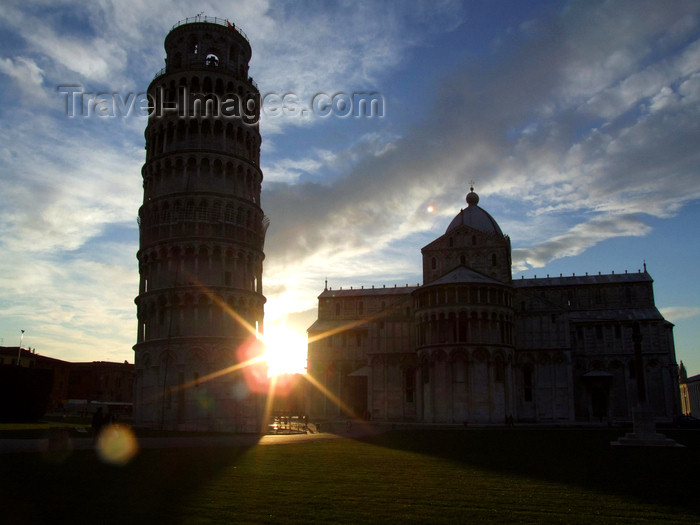 italy402: Pisa - Duomo and Pisa tower - silhouetted against the sun - photo by M.Bergsma - (c) Travel-Images.com - Stock Photography agency - Image Bank