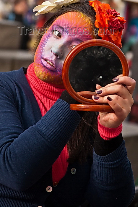 italy494: Carnival participant, Iast minute adjustments to make-up, Venice - photo by A.Beaton - (c) Travel-Images.com - Stock Photography agency - Image Bank