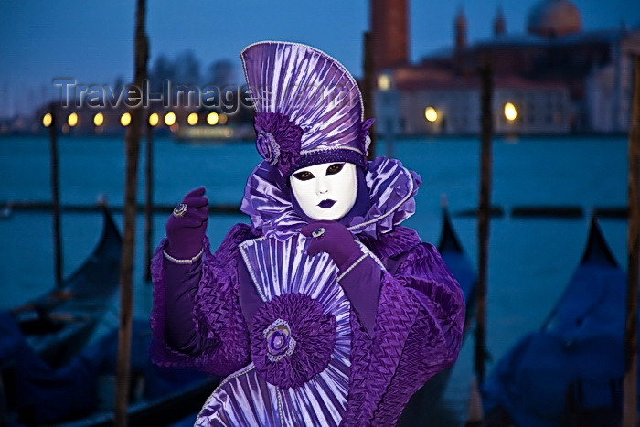 italy513: Carnival participant with Carnival costume at Dawn by Canale di San Marco, Venice - photo by A.Beaton - (c) Travel-Images.com - Stock Photography agency - Image Bank