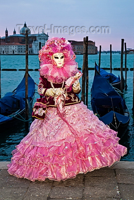 italy514: Carnival participant with Carnival costume at Dawn by Canale di San Marco, Venice - photo by A.Beaton - (c) Travel-Images.com - Stock Photography agency - Image Bank