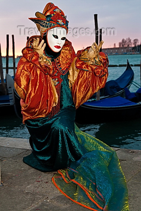italy515: Carnival participant with Carnival costume at Dawn by Canale di San Marco, Venice - photo by A.Beaton - (c) Travel-Images.com - Stock Photography agency - Image Bank