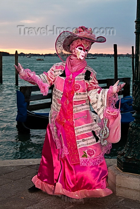 italy521: Carnival participant with Carnival costume at Dawn by Canale di San Marco, Venice - photo by A.Beaton - (c) Travel-Images.com - Stock Photography agency - Image Bank