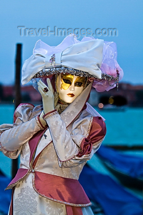 italy526: Carnival participant with Carnival costume at Dawn by Canale di San Marco, Venice - photo by A.Beaton - (c) Travel-Images.com - Stock Photography agency - Image Bank