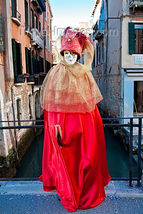 italy528: Carnival participant with Carnival costume on bridge overlooking canal, Venice - photo by A.Beaton - (c) Travel-Images.com - Stock Photography agency - Image Bank