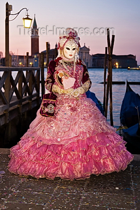 italy530: Carnival participant with Carnival costume at Dawn by Canale di San Marco, Venice - photo by A.Beaton - (c) Travel-Images.com - Stock Photography agency - Image Bank