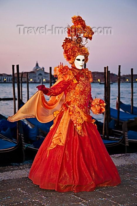 italy532: Carnival participant with Carnival costume at Dawn by Canale di San Marco, Venice - photo by A.Beaton - (c) Travel-Images.com - Stock Photography agency - Image Bank