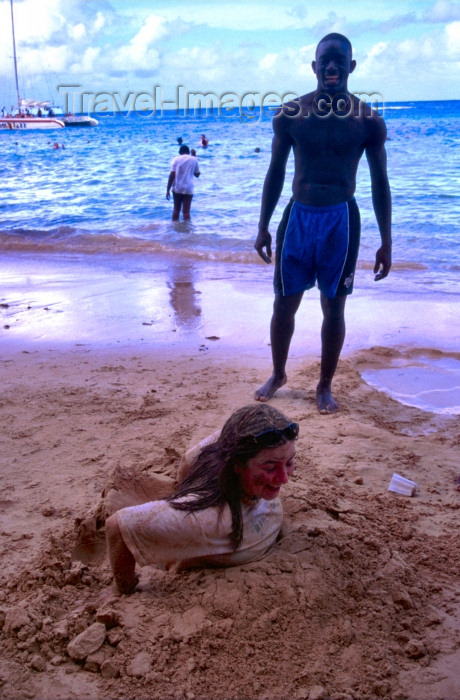 jamaica20: Jamaica - Montego Bay: girl buried in the sand (photo by Francisca Rigaud) - (c) Travel-Images.com - Stock Photography agency - Image Bank