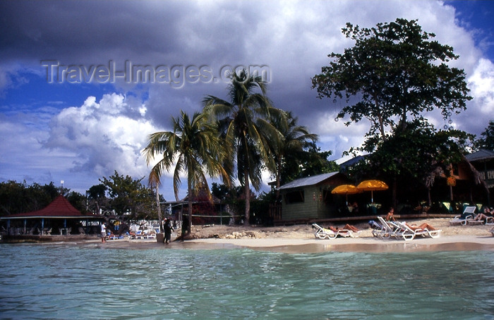 jamaica23: Jamaica - Negril: beach seen from the sea - beach chairs and waterfront restaurants - photo by T.Brown - (c) Travel-Images.com - Stock Photography agency - Image Bank