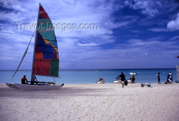 jamaica27: Jamaica - Negril: catamaran on a white sand beach - photo by T.Brown - (c) Travel-Images.com - Stock Photography agency - Image Bank