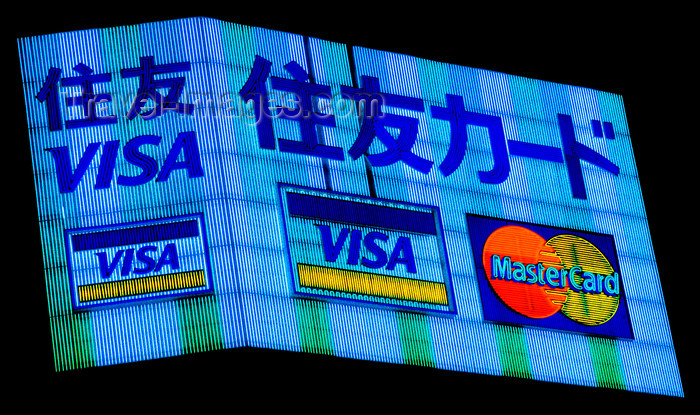 japan73: Neon advertising sign - credit cards, Tokyo, Japan. photo by B.Henry - (c) Travel-Images.com - Stock Photography agency - Image Bank
