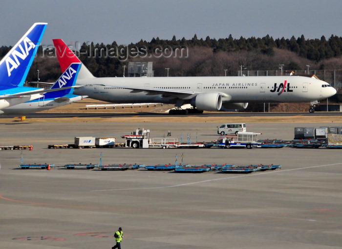 japan95: Narita, Chiba Prefecture, Japan: Narita International Airport (Tokyo Narita - NRT) - Japan Airlines (JAL) Boeing 777-346 (ER) cn 32436 taxiing before take off - tails of ANA aircraft on the left - photo by M.Torres - (c) Travel-Images.com - Stock Photography agency - Image Bank