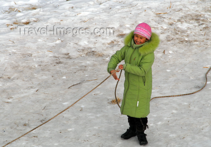 kazakhstan142: Kazakhstan - Chimbulak ski-resort, Almaty: woman using a rope to walk on the ice - photo by M.Torres - (c) Travel-Images.com - Stock Photography agency - Image Bank