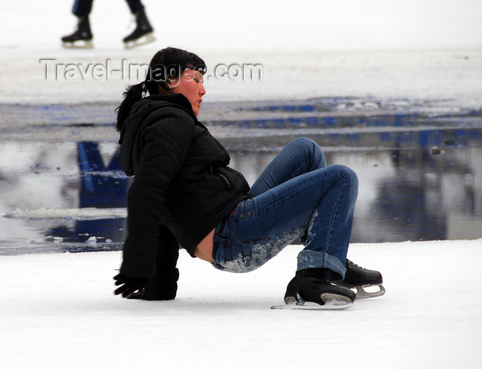 kazakhstan159: Kazakhstan,Medeu ice stadium, Almaty: a girl recovers from a fall - photo by M.Torres - (c) Travel-Images.com - Stock Photography agency - Image Bank