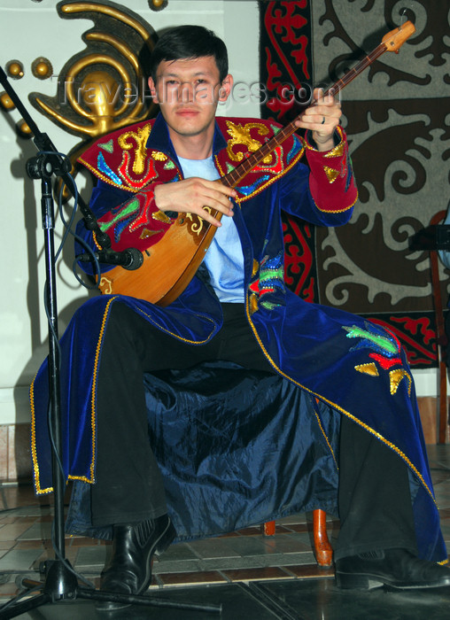 kazakhstan328: Kazakhstan, Central Asia - Almaty: playing a traditional dombra, a long-necked, stringed instrument - photo by M.Torres - (c) Travel-Images.com - Stock Photography agency - Image Bank