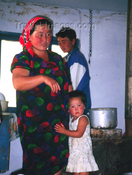 kazakhstan39: Kazakhstan - Almaty oblys: farmer's family in their house - photo by E.Petitalot - (c) Travel-Images.com - Stock Photography agency - Image Bank