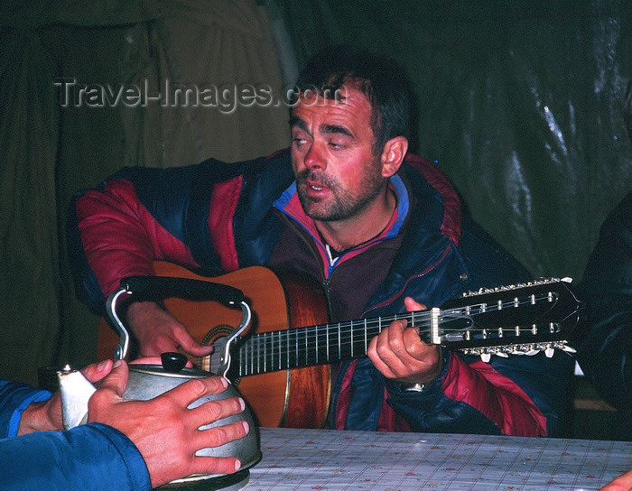 kazakhstan41: Kazakhstan - Almaty oblys: a guitarist plays and a man warms his hand on a kettle - photo by E.Petitalot - (c) Travel-Images.com - Stock Photography agency - Image Bank