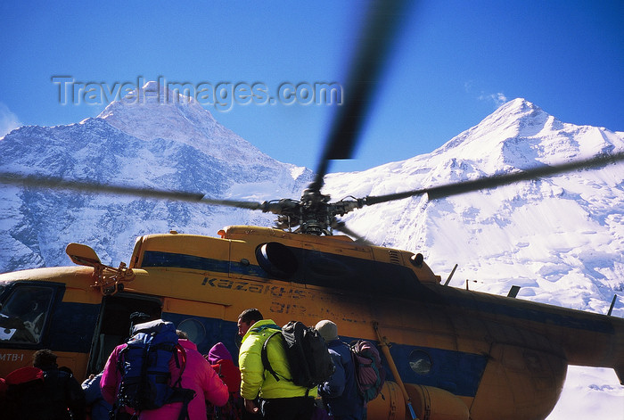 kazakhstan56: Kazakhstan - Tian Shan mountain range: mountaineers board a russian Mil Mi-8 Hip helicopter to leave from the Khan-Tengri base camp - photo by E.Petitalot - (c) Travel-Images.com - Stock Photography agency - Image Bank