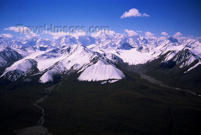 kazakhstan62: Kazakhstan - Tian Shan mountains and a river as it leaves a lake - photo by E.Petitalot - (c) Travel-Images.com - Stock Photography agency - Image Bank