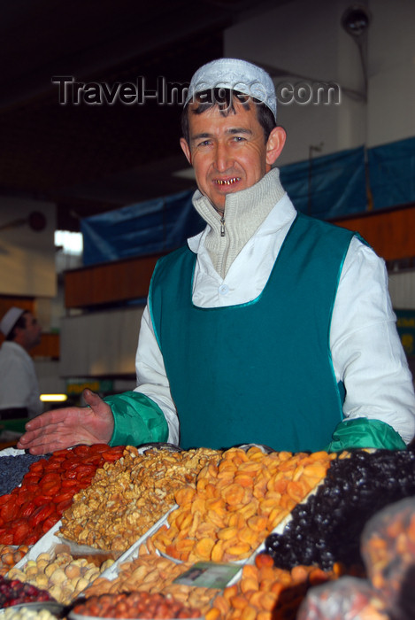 kazakhstan7: Kazakhstan, Almaty:green market, or Zelyoni Bazaar - Uzbek merchant with gold teeth selling dried fruits - photo by M.Torres - (c) Travel-Images.com - Stock Photography agency - Image Bank