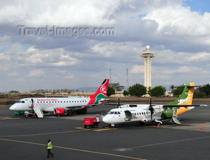 kenya78: Nairobi, Kenya: Jomo Kenyatta International Airport - control tower - 5H-PAP Udzungwa Precision Air ATR 42-320, cn 363 and 5Y-KYH Kenya Airways Embraer 170 - photo by M.Torres - (c) Travel-Images.com - Stock Photography agency - Image Bank