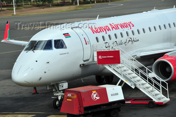 kenya79: Nairobi, Kenya: Jomo Kenyatta International Airport - Kenya Airways Embraer 170, 5Y-KYH and Houchin 140kVA Ground Power Unit - photo by M.Torres - (c) Travel-Images.com - Stock Photography agency - Image Bank