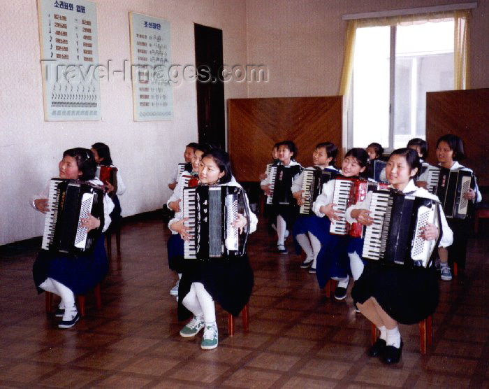korean135: North Korea / DPRK - Pyongyang: Children's palace - accordion performance (photo by M.Torres) - (c) Travel-Images.com - Stock Photography agency - Image Bank