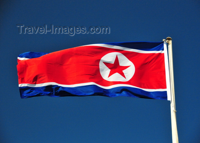 korean16: Pyongyang, North Korea / DPRK: the flag of the Democratic People's Republic of Korea flies in a deep blue sky - photo by M.Torres - (c) Travel-Images.com - Stock Photography agency - Image Bank