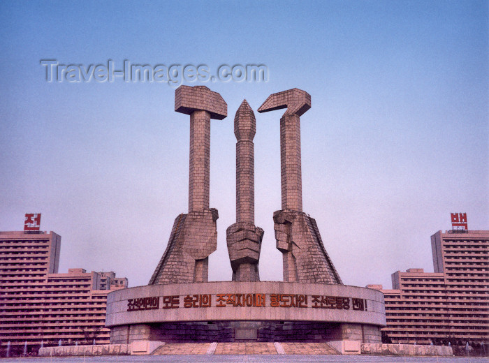 korean19: North Korea / DPRK - Pyongyang / FNJ: Monument to Party Foundation - hands holding a hammer, a hoe and a brush - Korean Workers' Party symbol - Munsu Street - photo by M.Torres - (c) Travel-Images.com - Stock Photography agency - Image Bank