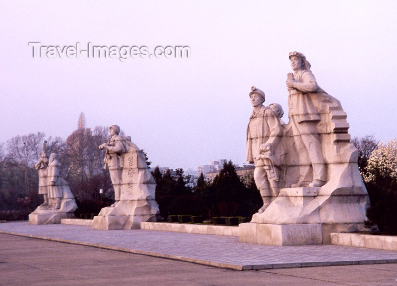 korean20: North Korea / DPRK - Pyongyang: statues by the Tower of the Juche Idea - symbolize Juche Industry, Impregnable Fortress and Longevity - photo by M.Torres - (c) Travel-Images.com - Stock Photography agency - Image Bank