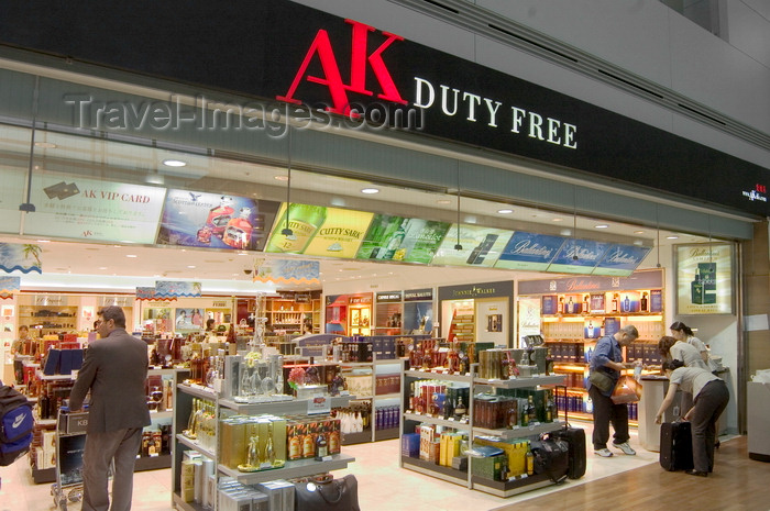 koreas79: Seoul, South Korea: airport terminal duty free store front of AK with clients and various products including spirits - Incheon International Airport - photo by C.Lovell - (c) Travel-Images.com - Stock Photography agency - Image Bank