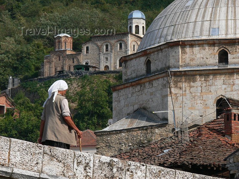 kosovo3: Kosovo - Prizren / Prizreni: woman on the bridge and dome of the Sinan Pasha mosque - photo by J.Kaman - (c) Travel-Images.com - Stock Photography agency - Image Bank