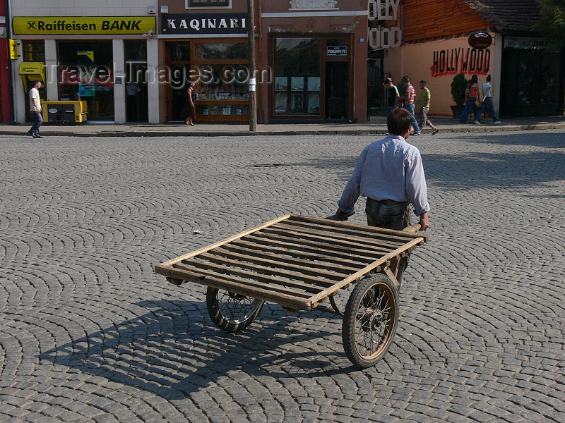 kosovo5: Kosovo - Prizren / Prizreni: street scene - man with a barrow / push cart / trolley - photo by J.Kaman - (c) Travel-Images.com - Stock Photography agency - Image Bank