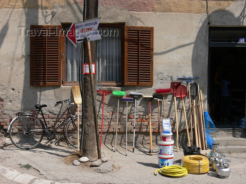 kosovo52: Kosovo - Pec / Peja: broom and hardware store - tools and 'medic' sign - photo by J.Kaman - (c) Travel-Images.com - Stock Photography agency - Image Bank