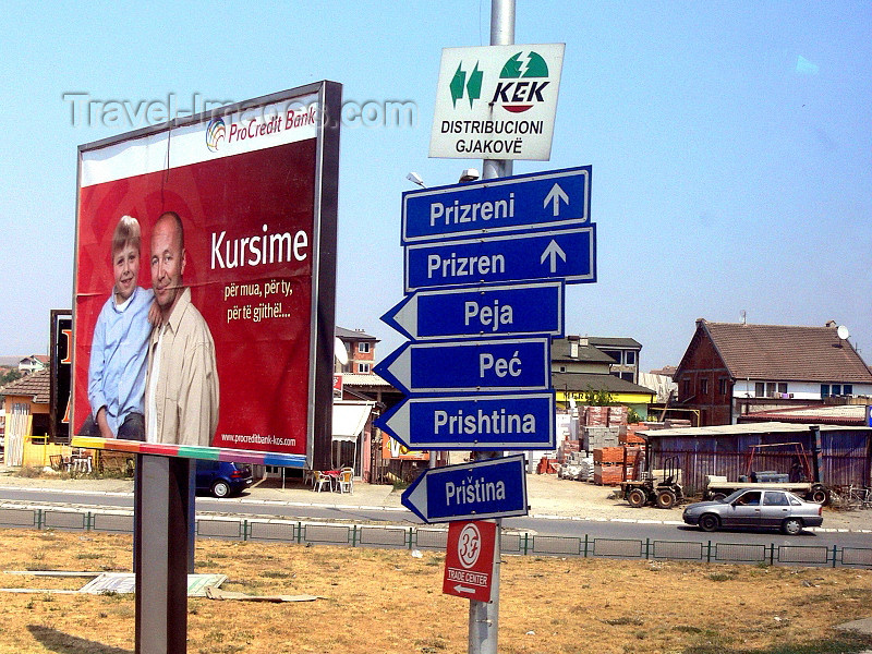 kosovo69: Kosovo - Bank billboard and direction boards by the road - photo by J.Kaman - (c) Travel-Images.com - Stock Photography agency - Image Bank