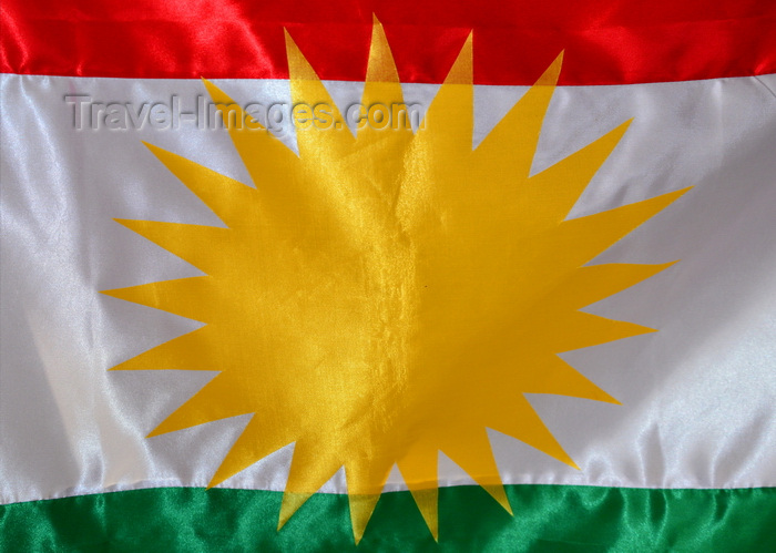 kurdistan100: Erbil / Hewler, Kurdistan, Iraq: flag of Kurdistan - Kurdish sun, detail of the Zoroastrian inspired sun disk and red, white and green stripes - photo by M.Torres - (c) Travel-Images.com - Stock Photography agency - Image Bank