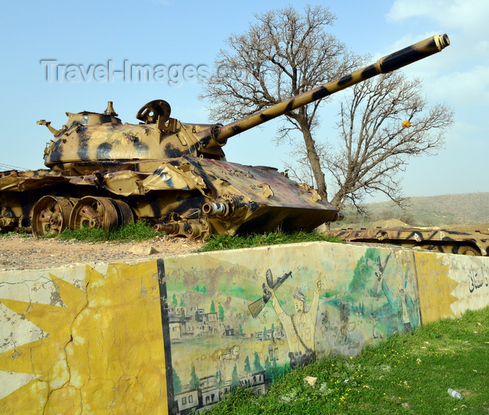 kurdistan99: Shera Swars, Kurdistan, Iraq: wrecked Iraqi army T-55 tanks, destroyed in combat by the Kurdish Peshmerga forces in a battle in 1991 - mural celebrating the Kurdish victory - photo by M.Torres - (c) Travel-Images.com - Stock Photography agency - Image Bank