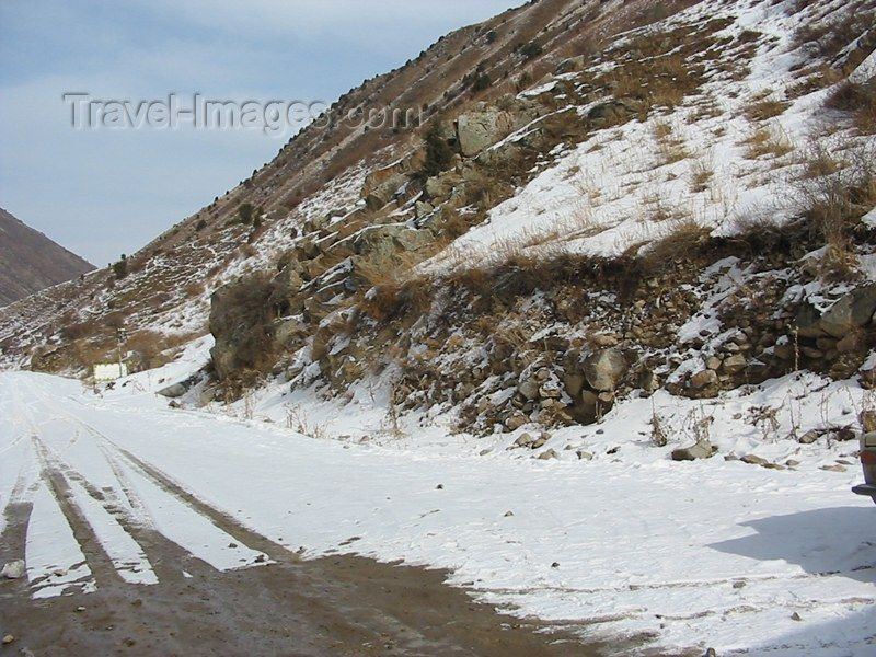 kyrgyzstan7: Kyrgyzstan - Chuy oblast: mountain road with snow - winter scene - Central Asian climate - photo by D.Ediev - (c) Travel-Images.com - Stock Photography agency - Image Bank