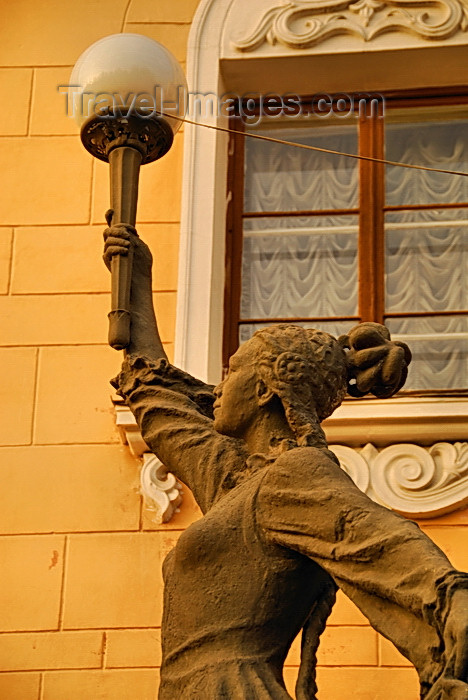 kyrgyzstan71: Bishkek, Kyrgyzstan: Opera and Ballet Theater - gracious statue carrying a lamp, contrasts with the stern Soviet architecture - Y.Abdrakhmanov street - photo by M.Torres - (c) Travel-Images.com - Stock Photography agency - Image Bank