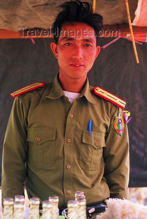 laos108: Laos: a Laotian policeman - photo by E.Petitalot - (c) Travel-Images.com - Stock Photography agency - Image Bank
