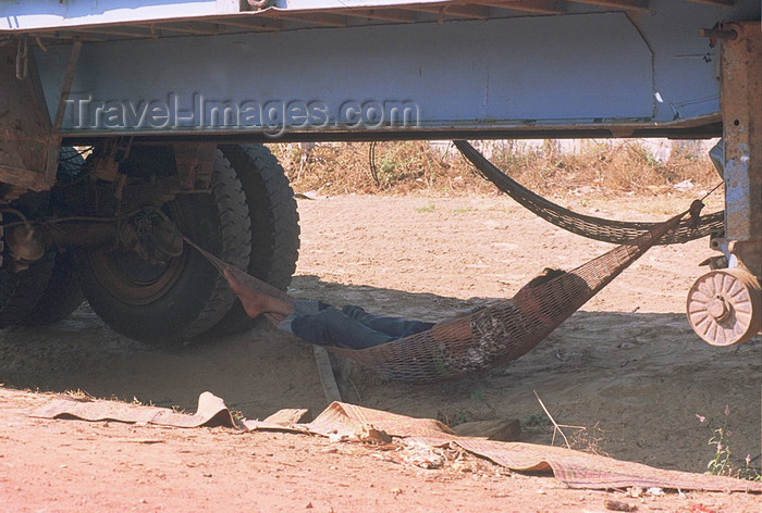 laos109: Laos: a driver takes time off in a hammock in the shade under his truck - photo by E.Petitalot - (c) Travel-Images.com - Stock Photography agency - Image Bank