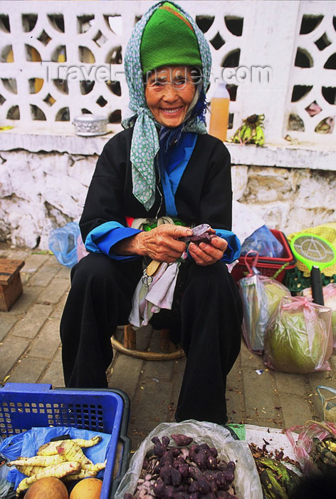 laos114: Laos: a smiling old woman is selling food at the market - photo by E.Petitalot - (c) Travel-Images.com - Stock Photography agency - Image Bank