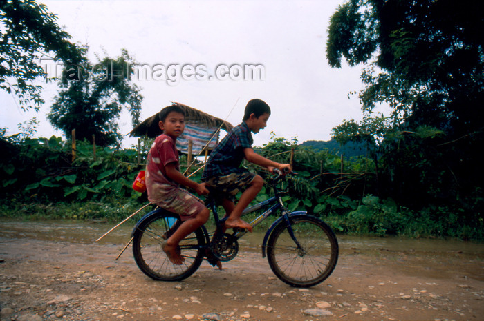 laos66: Laos - Vang Vieng - Children going to fish - tow on a bike - photo by  - photo by K.Strobel - (c) Travel-Images.com - Stock Photography agency - Image Bank