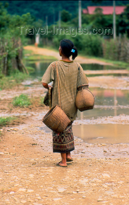 laos70: Laos - Vang Vieng - woman walking with jars - photo by K.Strobel - (c) Travel-Images.com - Stock Photography agency - Image Bank